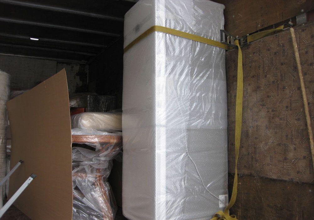 Холодильник в вертикальном положении